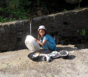 Young Nepali girl washing basin