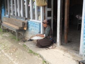 Nepali women sorting corn