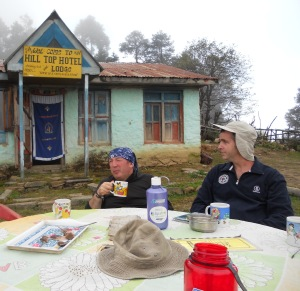 2 men dringking tea at a mountain lodge