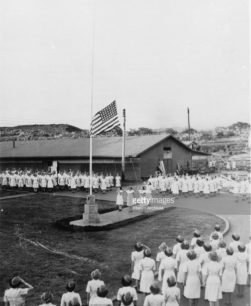 Soon arrving in Hawaii, women Marine Reserves stand to for evening colors at Pearl Harbor, during World War II, 1940s. (Photo by US Marine Corps/Interim Archives/Getty Images)