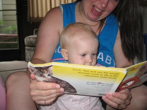 Enjoying her first favorite book - photo by Joelle
