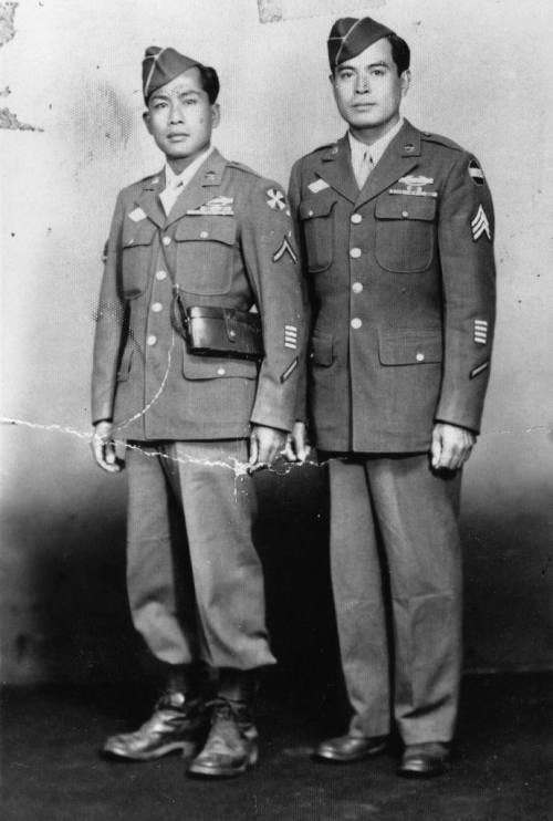 Portrait of Anacieto Soriano, Sr. (at right) and unidentified friend wearing their 1st Filipino Infantry Regiment uniforms from World War II. Copyright © 2011 The Regents of The University of California. Click through for source page.